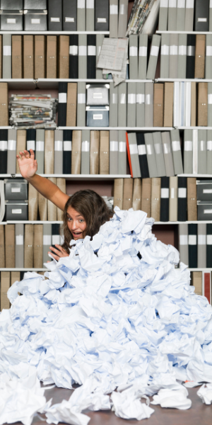 Desk and paralegal buried in paper
